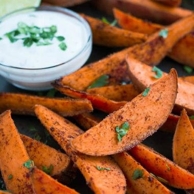 Skip the greasy fries and enjoy these scrumptious baked Sweet Potato Wedges with Honey Lime Dip!