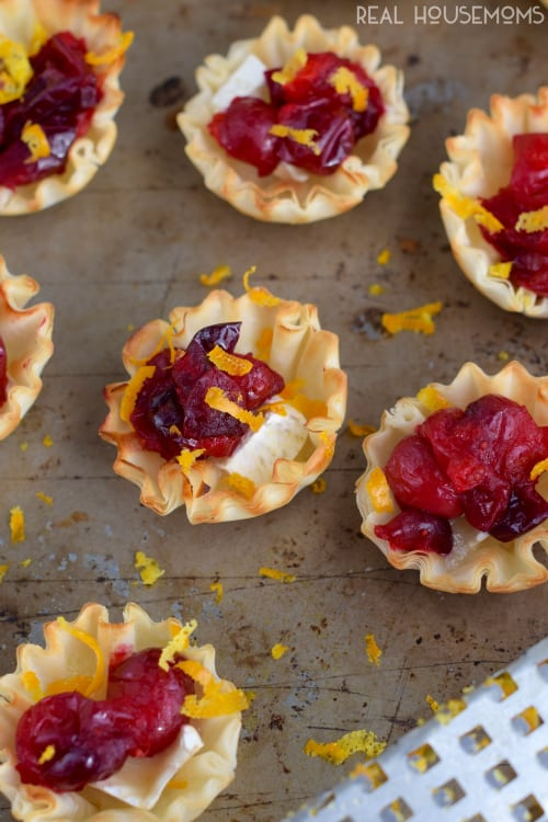 These CRANBERRY BRIE CUPS are just about as easy an appetizer as you can get, and they are so beautiful and delicious!