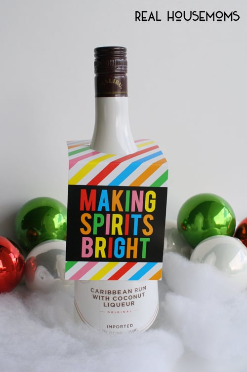 Spread a little holiday cheer to the adults in your neighborhood, friends or co-workers this year by delivering your favorite adult beverage paired with these FREE PRINTABLE HOLIDAY BOOZY BOTTLE GIFT TAGS!