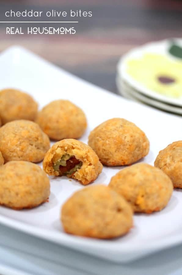 These CHEDDAR OLIVE BITES are packed with tangy, cheesy flavor- your guests will devour them!
