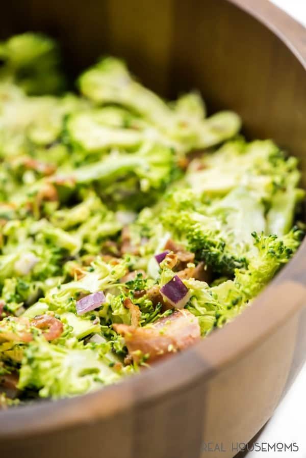 BACON BROCCOLI SLAW is a very simple recipe that tastes amazing! Smokey bacon combine with the crisp broccoli and tangy dressing to make a great side dish for any time of year!