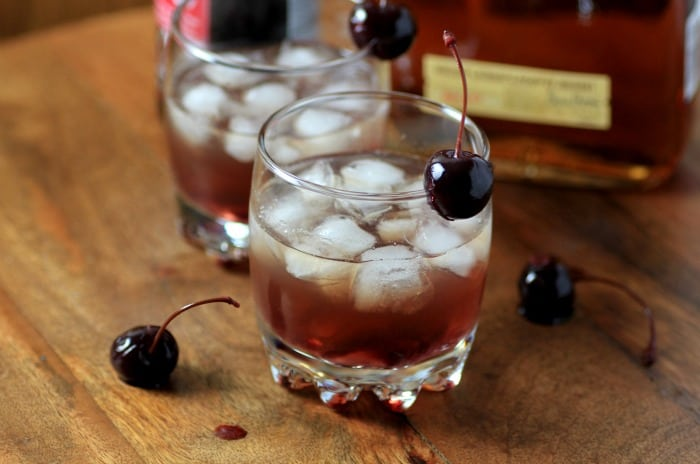 Our BOURBON CHERRY SMASH is a whiskey cocktail with the wonderful flavors of cherry that's brightened up with meyer lemon simple syrup!