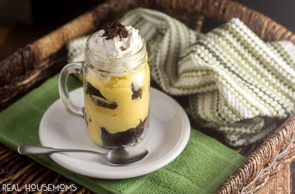 Our IRISH CREAM BROWNIE PARFAIT makes a perfect dessert for St. Patrick's Day with its layers of delicious chocolate fudge brownies and pudding in a mason jar or parfait glass!