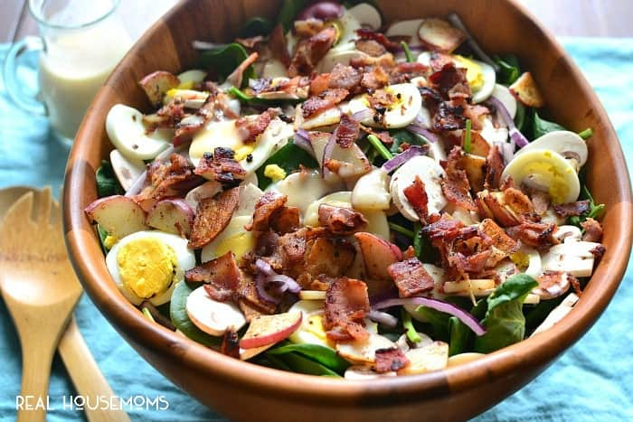 SPINACH SALAD WITH WARM MAPLE BACON DRESSING is the ultimate twist on a classic! It's loaded with delicious flavor and perfect for lunch, dinner, or your next get together!