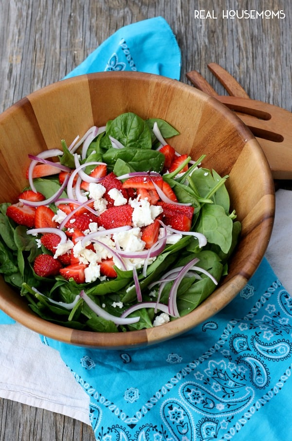 Lighten up with a big bowl of STRAWBERRY & GOAT CHEESE SPINACH SALAD with an easy and delicious homemade Strawberry Vinaigrette!