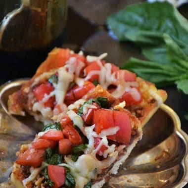 CAPRESE BRUSCHETTA is an easy recipe loaded with flavor! We love making some for an easy appetizer or to enjoy for pizza night during the week!