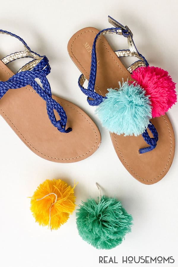 Sandals with handmade pom poms