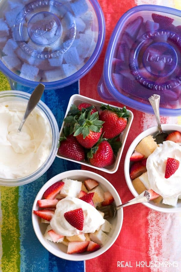Strawberry Shortcake served in bowls alongside GladWare® containers filled with angel food cake, strawberries, and whipped cream