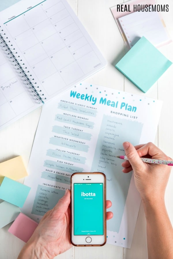 Writing shopping list on meal plan printable