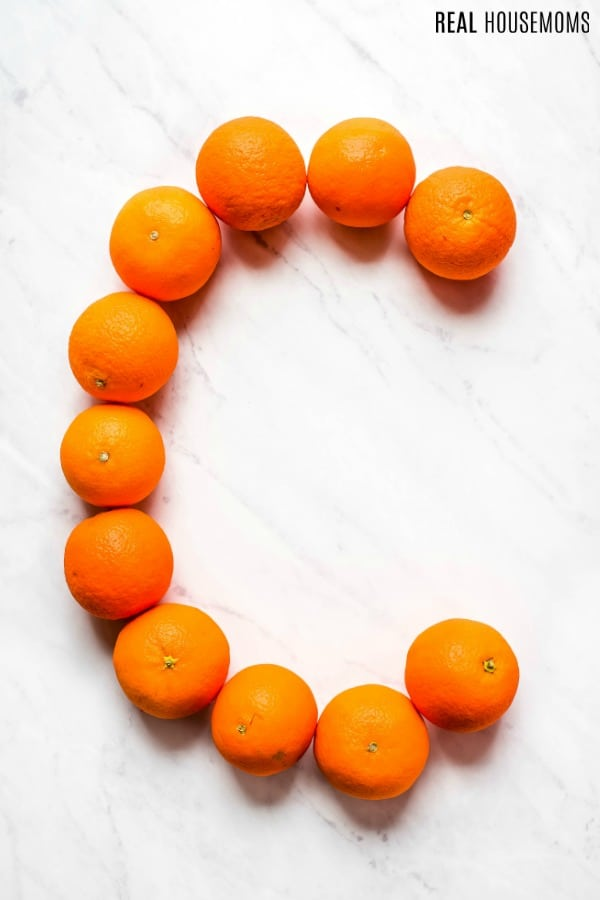 oranges on a counter top arranged to form a C