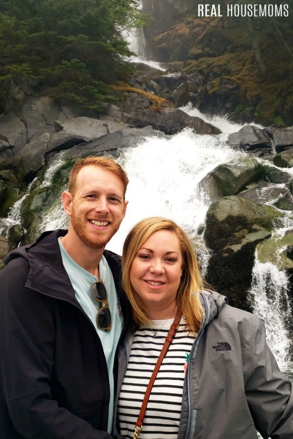 my husband and me at a waterfall in Alaska