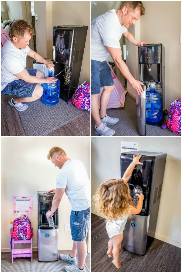 man refilling a bottom-loading primo water dispenser and family members filling water bottles