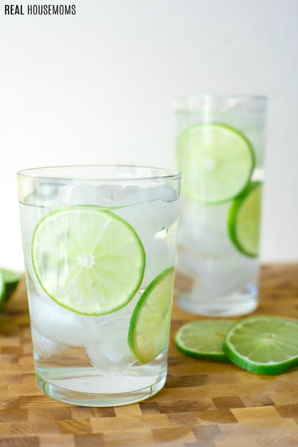 glasses of water with lime slices