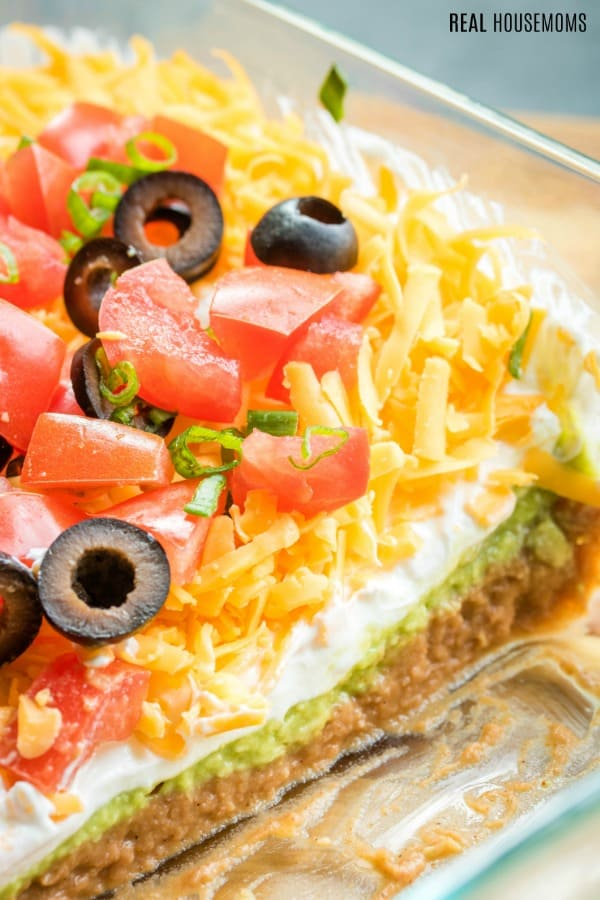 7 layer dip in glass pin with some of the dip eaten showing layers