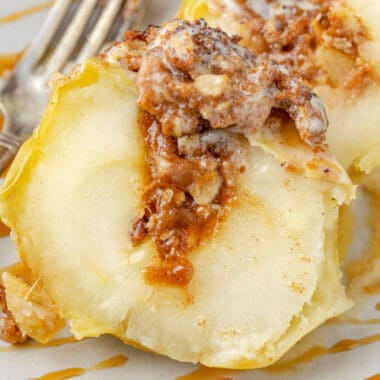 square image of air fryer baked apple cut open to show filling inside