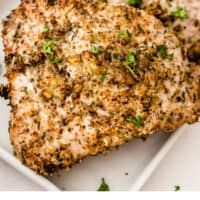 air fryer pork chops on a platter with recipe name at bottom