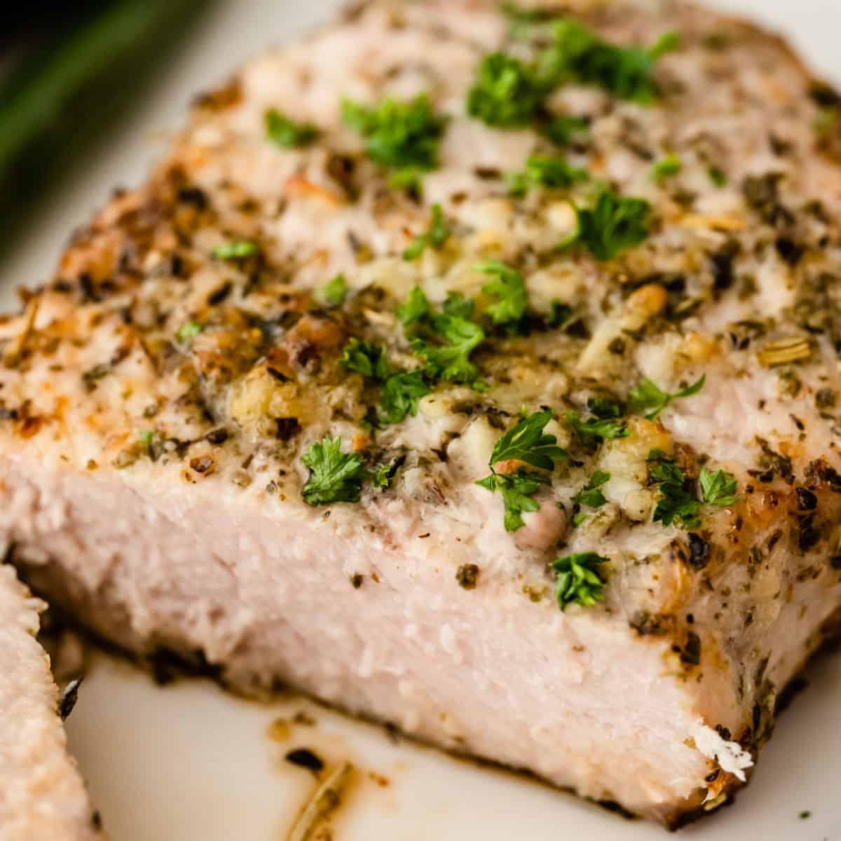 square close up of an air fryer pork chop cut in half