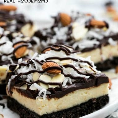 Chocolate and coconut are the stars of these incredibly yummy ALMOND JOY CHEESECAKE BARS! They're easy to make and are the hit of every party!
