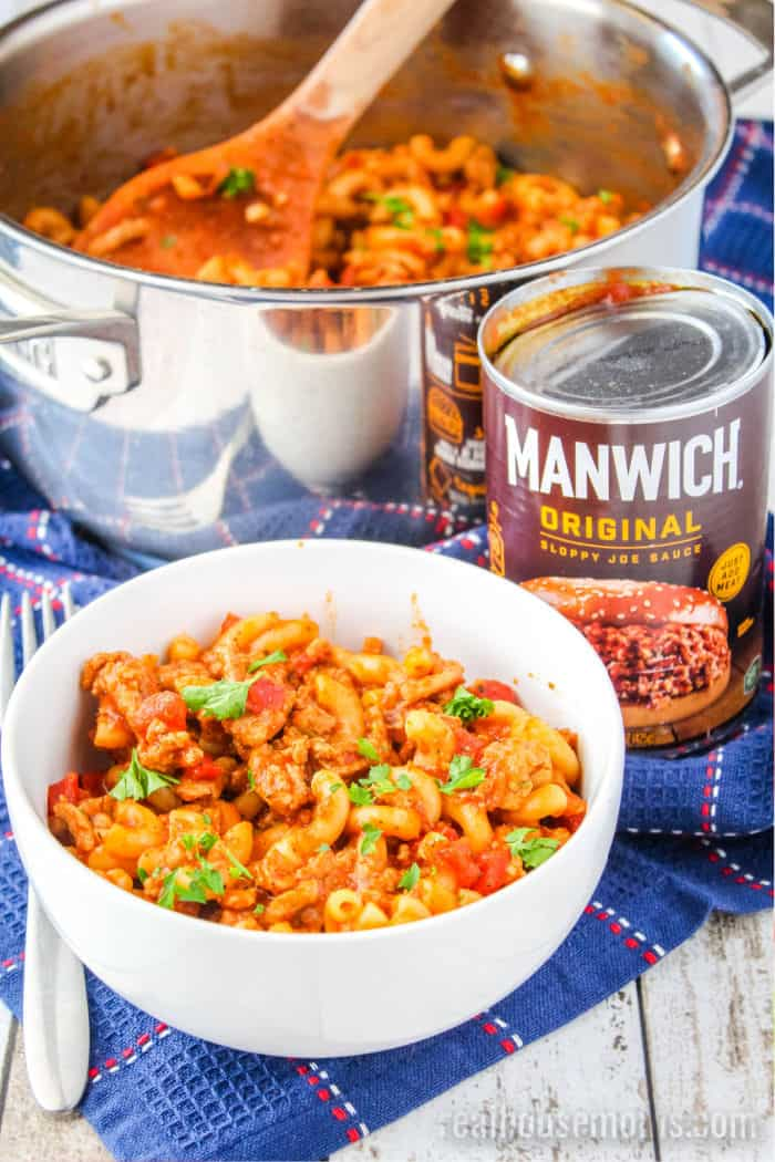 bowl of goulash next to pot it was cooked in and a can of Manwich original sauce