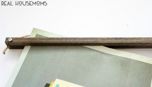 With a couple supply items, you can make a DIY WOODEN PICTURE HANGER for a fraction of the cost of the one from Anthropologie!