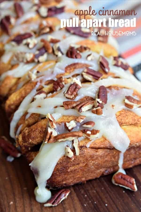 This easy APPLE CINNAMON PULL APART BREAD recipe is perfect for fall with baked apples, cinnamon sugar, and a sweet cream cheese glaze!