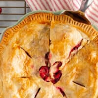one pic collage of apple cranberry pie, pic of whole pie on a baking rack with a white and red napkin