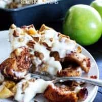 Apple Pie Cinnamon Roll Bake is an easy breakfast casserole with chunks of cinnamon rolls, apple, cinnamon, pecans and cream cheese icing!