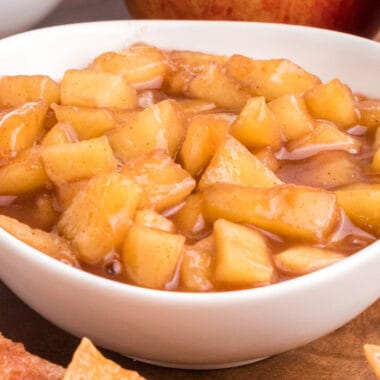 square close up image of apple pie dip in a bowl