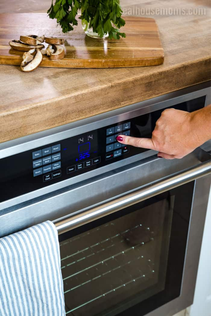 inputting bake settings on aBeko wall oven