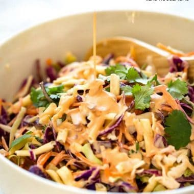 This Asian Slaw is everything you know and love about classic slaw with a fantastic Asian twist! It's made with an Asian Mayonnaise Dressing and crunchy noodles added for extra texture. I can't get enough of this!