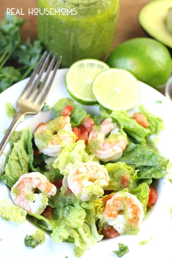 Avocado Cilantro Lime Shrimp Salad served in a salad bowl with lime wheels on the side
