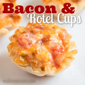 A closeup of a phyllo cup filled with cheesy bacon and Rotel.