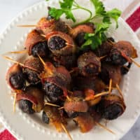The perfect blend of sweet and salty, Bacon Wrapped Figs are a unique appetizer that's sure to impress your guests! You can even prep them ahead of time and bake 'em later!