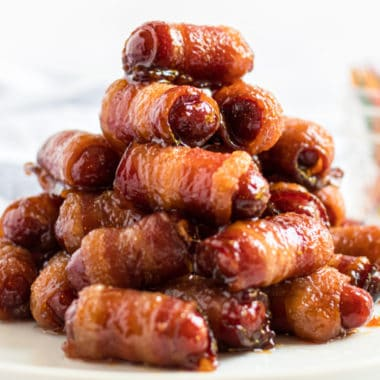 Bacon Wrapped Smokies are a classic holiday party and football game appetizer! You'll go crazy for the delicious brown sugar glaze!