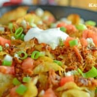 PULLED PORK POTATO CHIP NACHOS are a new twist on an old favorite! Crispy kettle chips, tangy BBQ & two cheeses make this is an appetizer everyone will enjoy!