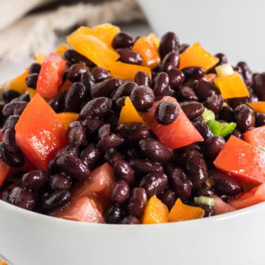 Tangy, bright & full of nutrition, Black Bean Salad is the perfect dish to share with friends! Use it as a dip or an appetizer - your guests will LOVE it!