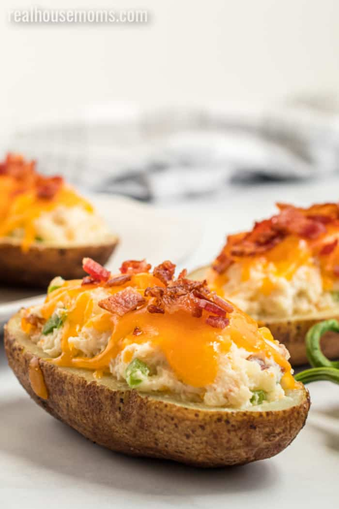 twice baked potatoes with cheese, bacon, and jalapeno