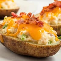 Bacon Jalapeno Popper Twice Baked Potatoes combine the amazing flavors of bacon, cheese, jalapenos, and potatoes! How could you go wrong?