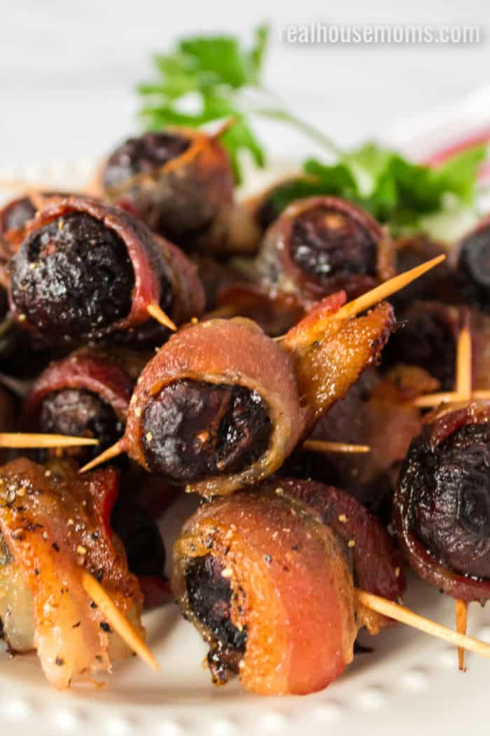 close up of a plate of bacon wrapped figs