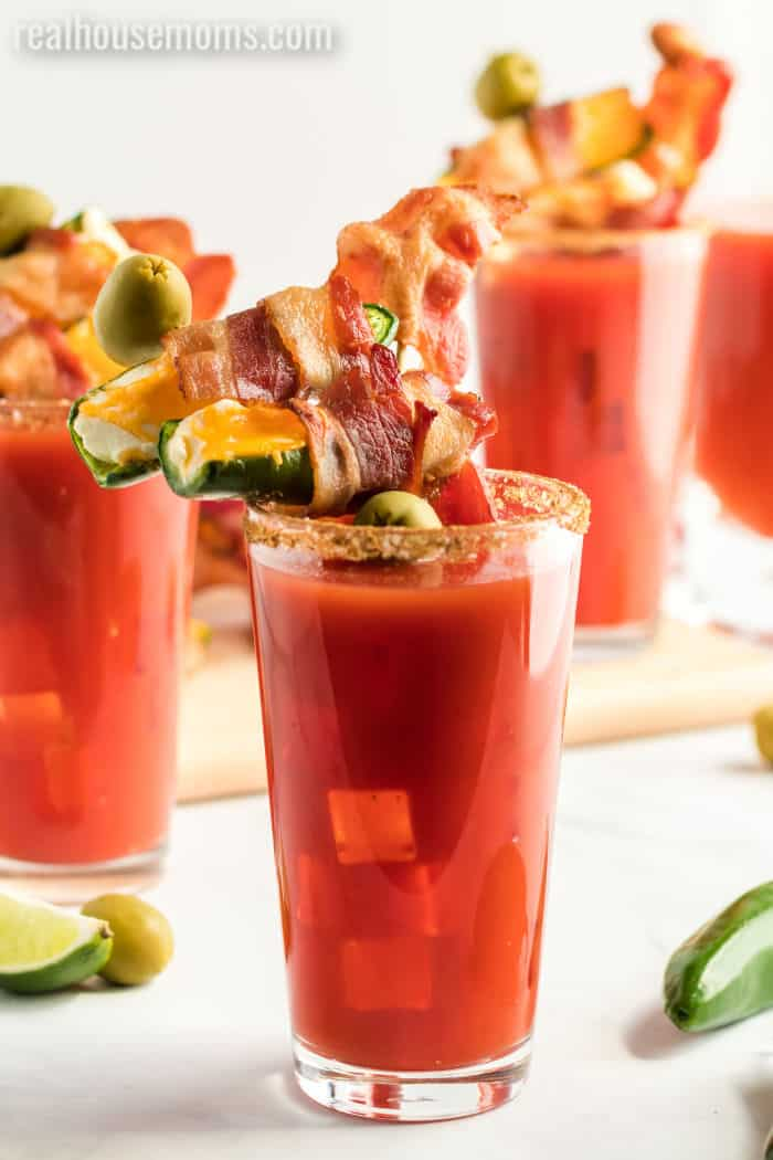 bacon wrapped jalapeno popper bloody mary garnished with bacon