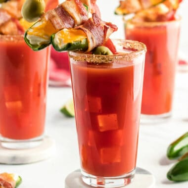 Bacon? Jalapeno poppers? Alcohol? Bacon Wrapped Jalapeno Popper Bloody Mary is a brunch lover's dream come true! Mornings were made for sipping this drink!