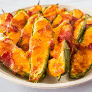 Bacon Wrapped Jalapeno Poppers are the party app you need to make. Loaded with a cheesy cream cheese mixture and baked to perfection, no one can resist!