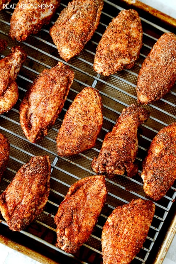 Chili Rub Chicken Wings on a baking sheet ready to be baked