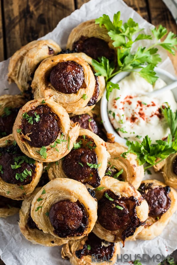 These delicious Chorizo Pinwheel Bites are stuffed with cheddar, drizzled with honey, and then baked until the pastry is puffed and golden. They can even be made a day ahead for a quick and easy appetizer!