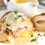 This Baked Ham and Cheese Stuffed Chicken is EPIC! Chicken breast stuffed with ham and cheese, then baked to juicy perfection and served with a simple yet wickedly delicious Mustard Cream Sauce. This is stellar for a quick midweek meal!