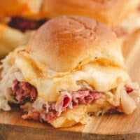square image of reuben sliders on a cutting board