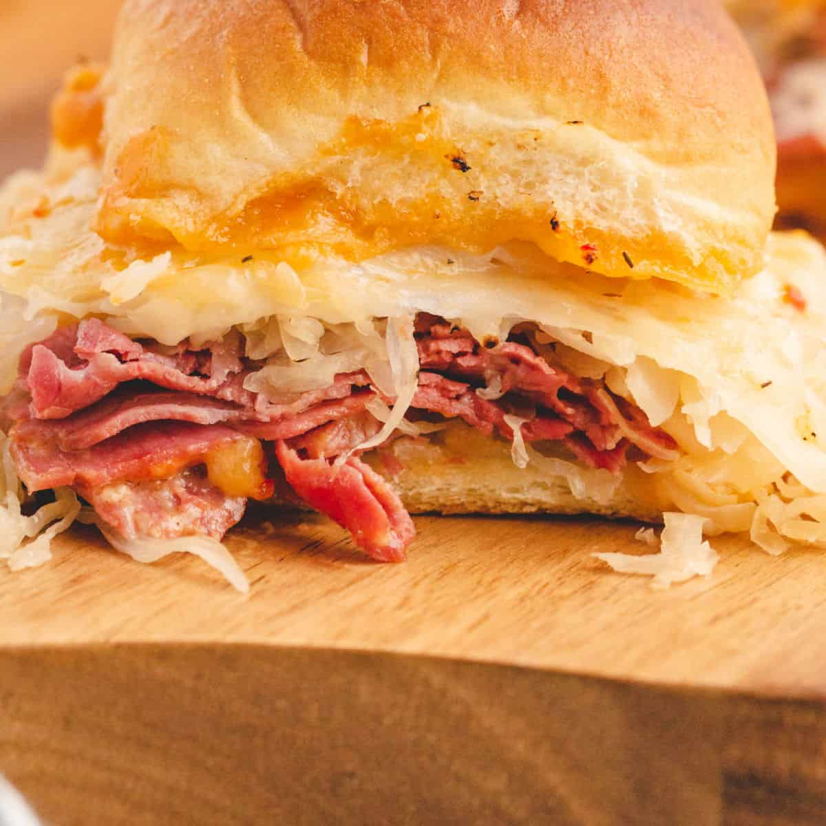 close up of baked reuben slider on a cutting board