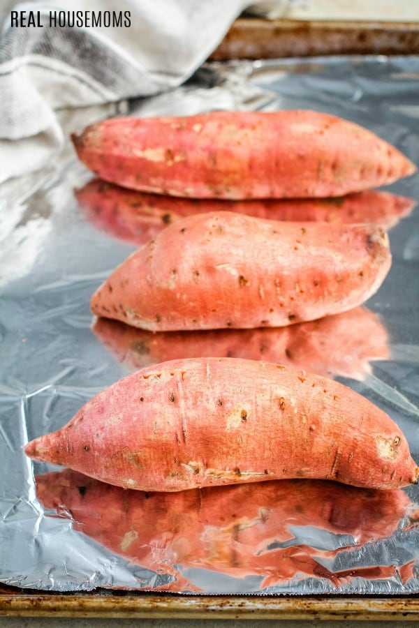 sweet potatoes on a baking sheet before cooking