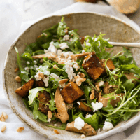 This Balsamic Pumpkin & Chicken Salad is made with sweet, golden roasted pumpkin and chicken tossed with arugula leaves and a wicked Honey Balsamic Dressing. THIS is a salad worthy of being a meal!