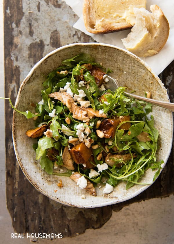 Bowl of Balsamic Pumpkin & Chicken Salad with a fork and crusty bread along side